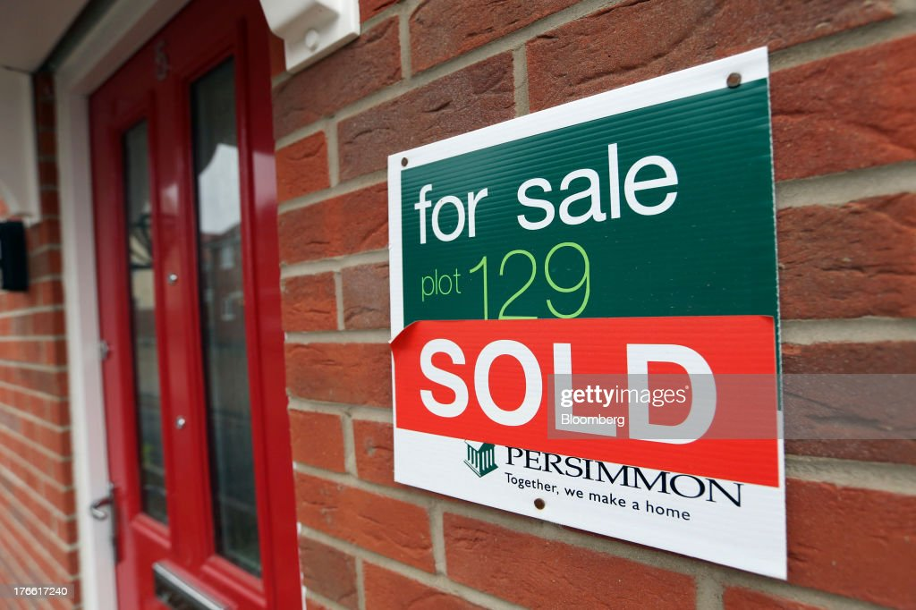 A 'Sold' sign sits taped to a 'For Sale' sign on the wall of a newly constructed house at a Persimmon Plc residential building site in Romford, U.K., on Friday, Aug. 16, 2013. Persimmon, the largest homebuilder by market value, said in July that its operating margin widened to about 15 percent during the half from 12.1 percent. Photographer: Chris Ratcliffe/Bloomberg via Getty Images