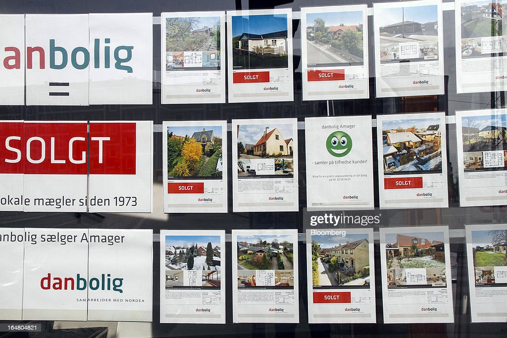 A 'Sold' sign sits with advertisements for residential apartments and houses displayed in the window display of an estate agent in Copenhagen, Denmark, on Thursday, March 28, 2013. Denmark's government rejected a plan by mortgage banks last week to split troubled loans and extend interest-only terms for amounts below an 80 percent loan-to-value limit. Photographer: Freya Ingrid Morales/Bloomberg via Getty Images