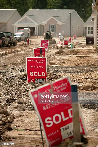 Sold signs lie in front of newly constructed homes at Sun City Huntley housing development May 24 2006 in Huntley Illinois The Commerce Department...
