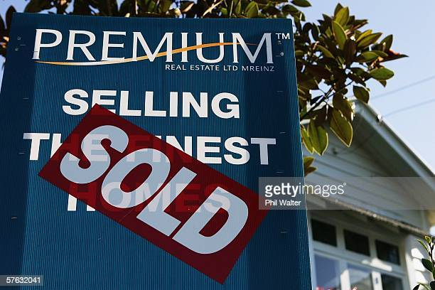 A sold sticker is placed on a real estate sign outside a house May 17 2006 in Auckland New Zealand Despite the recent increase in home mortgage rates...