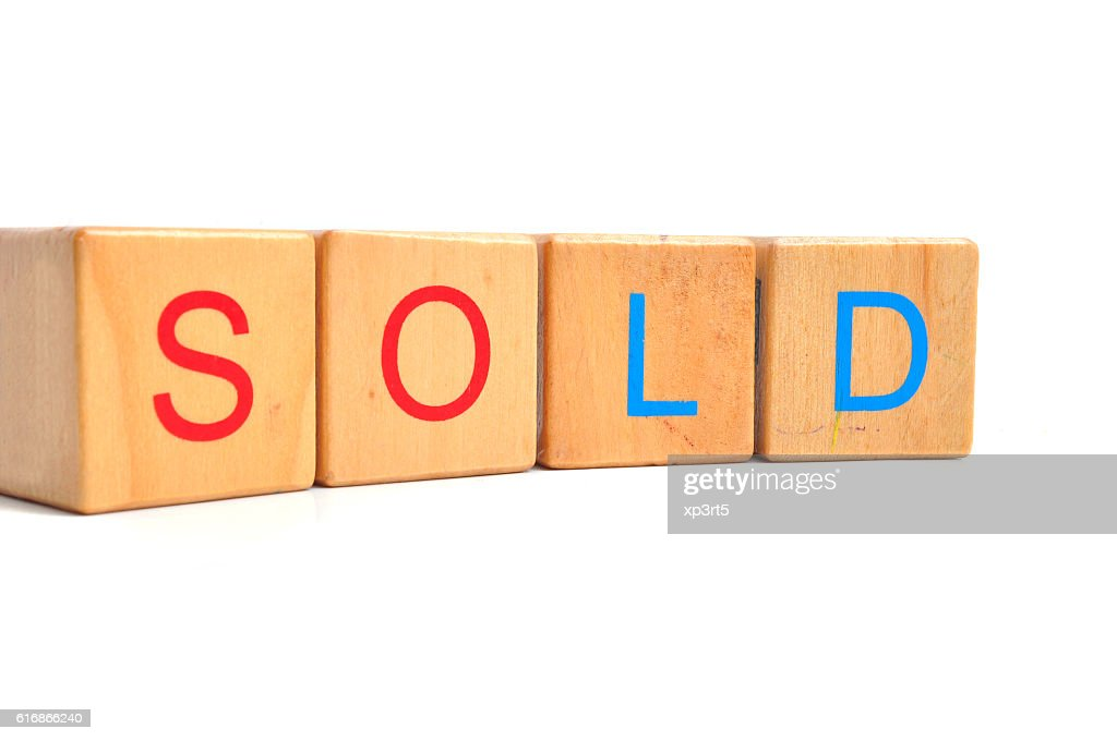 Sold Text on wooden block : Stock Photo