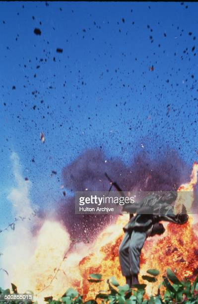 A solder falls after an explosion goes off in a scene from the movie 'The Wild Geese' circa 1978