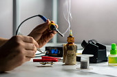 soldering iron with smoke from boiling rosin or colophony