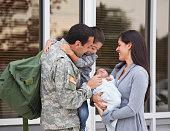 Soldier admiring his newborn baby