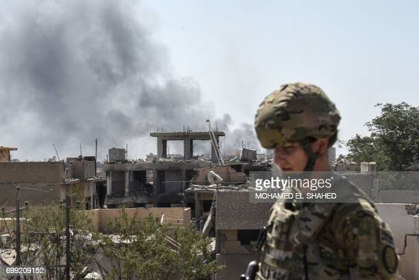 A US soldier advising Iraqi forces is seen in the city of Mosul on June 21 during the ongoing offensive by Iraqi troops to retake the last district...
