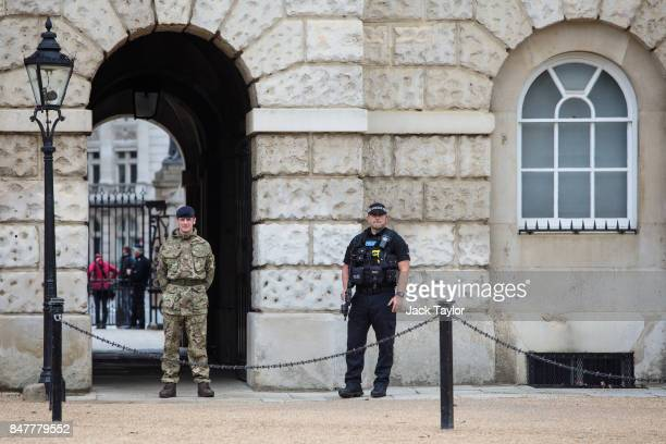 A soldier and an armed police officer stand guard in Horse Guards Parade on September 16 2017 in London England An 18yearold man has been arrested in...