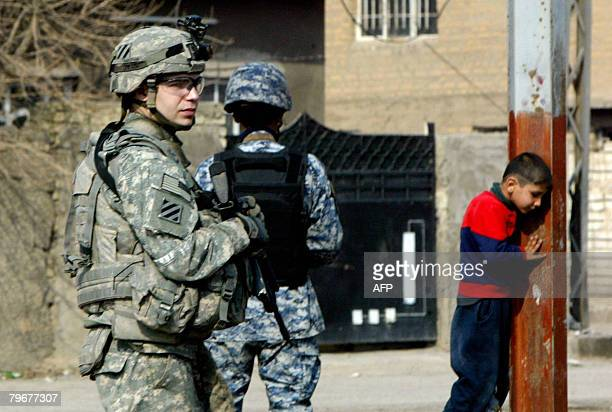 A US soldier and an Iraqi police commando patrol in Baghdad's alAmil neighbourhood on February 9 2008 Five US soldiers were killed yesterday in Iraq...
