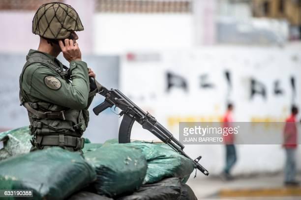 A soldier behind sandbags custody the Miraflores presidential house whilst Venezuelan President Nicolas Maduro and his vicepresident Tareck El...