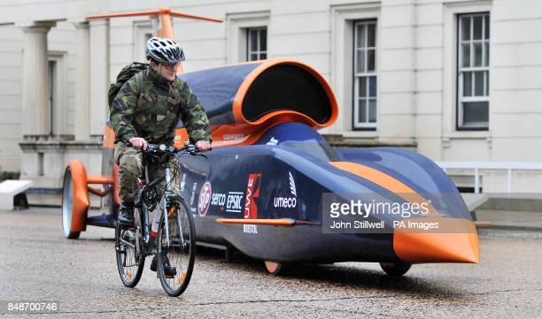 A soldier cycles past the Bloodhound Project jet engine and hybrid rocket motor powered car at the Wellington barracks in central London as Defence...