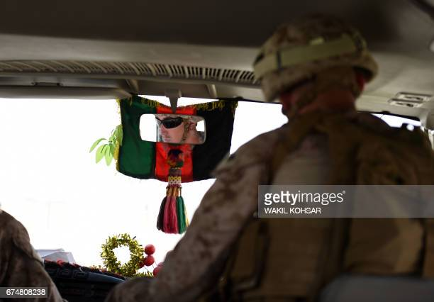 US soldier drives a bus ahead of handover ceremony at Leatherneck Camp in Lashkar Gah in the Afghan province of Helmand on April 29 2017 US Marines...