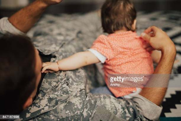 US soldier enjoying precious time with his daughter