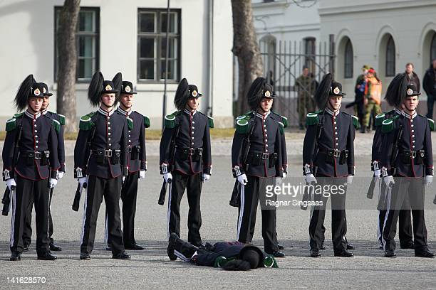 A soldier faints as King Harald V of Norway and Prince Charles Prince of Wales attend a wreath laying ceremony at the National Monument at Akershus...