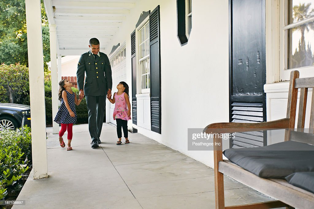Soldier father with daughters on patio