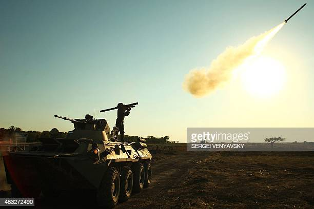 A soldier fires a portable air defense rocket during the International military games 'Masters of Antiaircraft Battle 2015' outside the Russian...