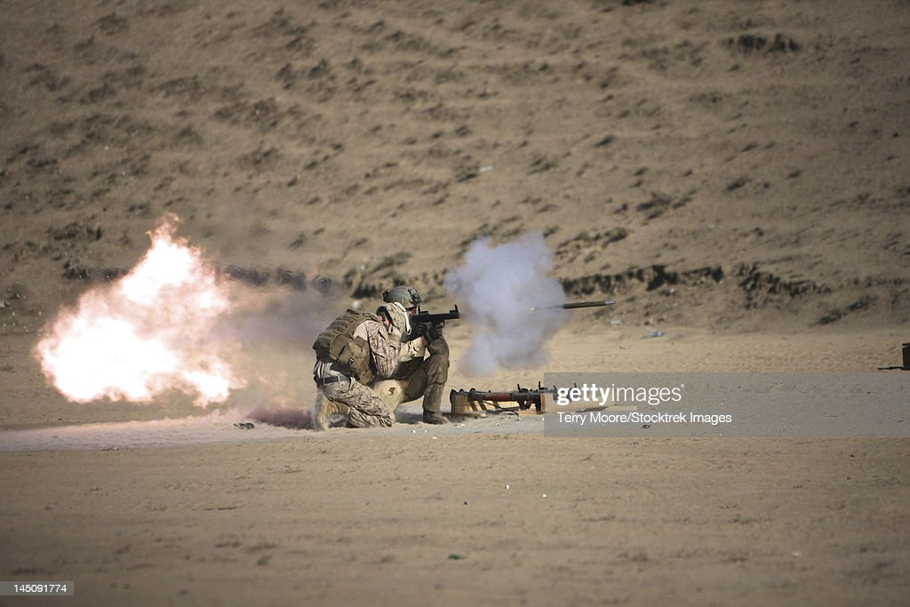 A soldier fires a rocket-propelled grenade launcher.