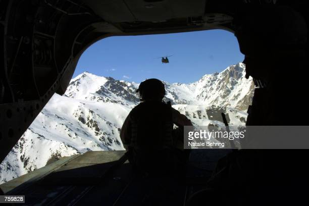 S soldier flies over the Hindu Kush after delivering aid to earthquake victims March 28 2002 in the northern town of Nahrin A powerful earthquake...