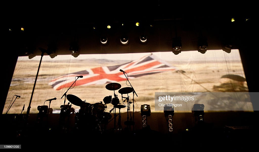 A soldier flying The Union Jack flag during The Falklands war in a projection at the begining of The Specials performance at Nottingham Capital FM Arena on October 21, 2011 in Nottingham, United Kingdom.
