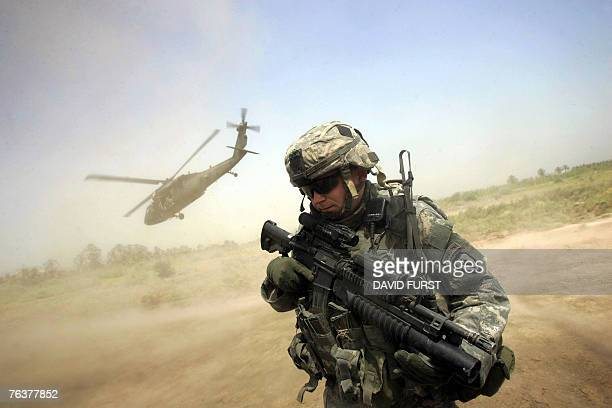 A US soldier from 1501 ParaInfantry Regiment turns his back to the helicopter carrying Major General Rick Lynch commander of US forces in central...