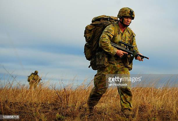 A soldier from 3 RAR starts patrolling after a paratroop drop during an airborne combat team exercise as part of a combined Arms training activity on...