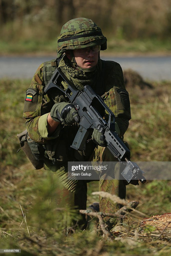 A soldier from Lithuania pauses during a counterattack in an ambush by Ukrainan soldiers on the third day of the 'Rapid Trident' bilateral military...