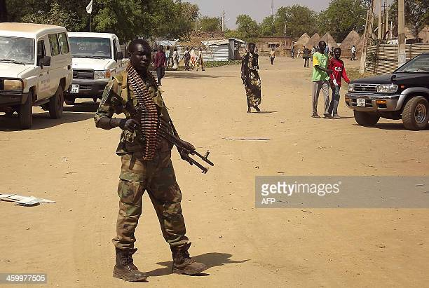 A soldier from South Sudan's army stands guard in Malakal in the Upper Nile State of South Sudan on December 31 2013 South Sudan's warring parties...