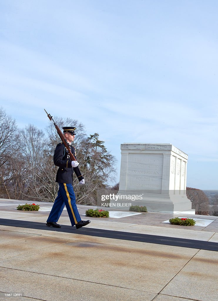 A soldier from the 3rd United States Infantry Regiment, 'The Old Guard,' Tomb Guard, walks his post at the Tomb of the Unknowns, December 25, 2012 in Arlington National Cemetery in Virginia. AFP PHOTO /Karen BLEIER