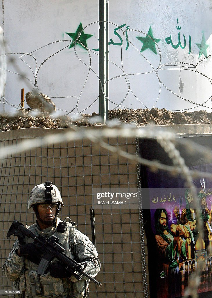 A US soldier from the 6th Squadron, 8th Cavalry Regiment guards an area as his unit patrols a neighbourhood in southern Baghdad, 24 January 2008. A suicide bomber disguised as a policeman killed the provincial police chief for Iraq's main northern city of Mosul today as he visited the scene of an earlier blast in which 34 people died, police said. AFP PHOTO/Jewel SAMAD