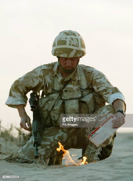 A soldier from the British 29 Commando Regiment Royal Artillery 'sanitises' his kit by burning his personal mail in the Kuwait desert near the Iraqi...
