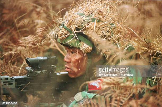 A soldier from the company of Gurkhas that is to fly out to Bosnia shortly in their first operational deployment since the Falklands conflict trains...