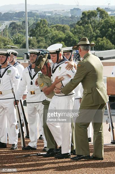 A soldier from the Guard of Honour faints while awaiting the arrival of British Prime Minister Tony Blair on the forecourt of The Australian...
