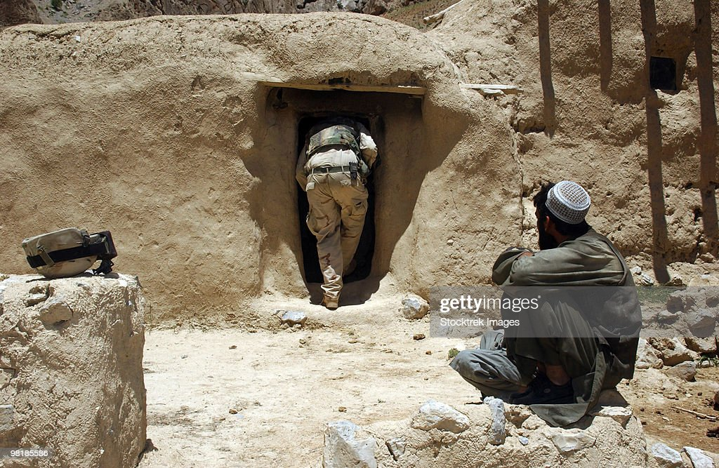 A soldier from the National Guard searches the home of a suspected Taliban member in Afghanistan.
