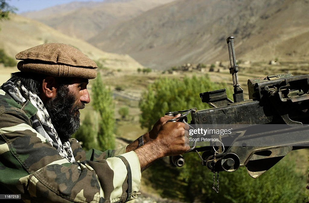 A soldier from the opposition Northern Alliance who now call themselves the United Front aims a gun as the rebels prepare for conflict October 1 2001...