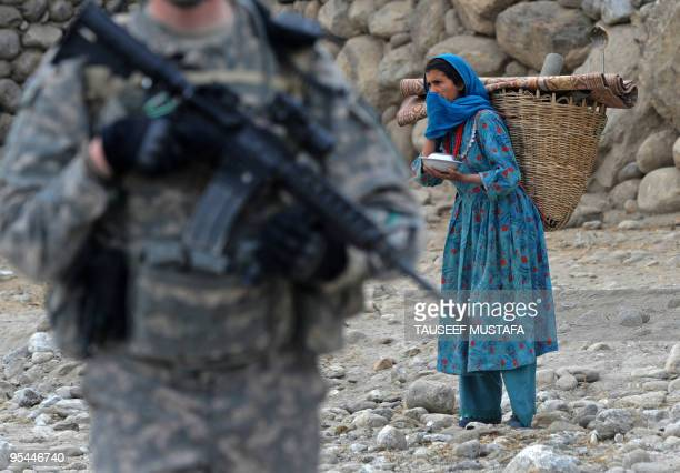 A US soldier from the Provincial Reconstruction team Steel Warriors patrols in Nuristan Province on December 27 2009 A bomb attack killed a US...