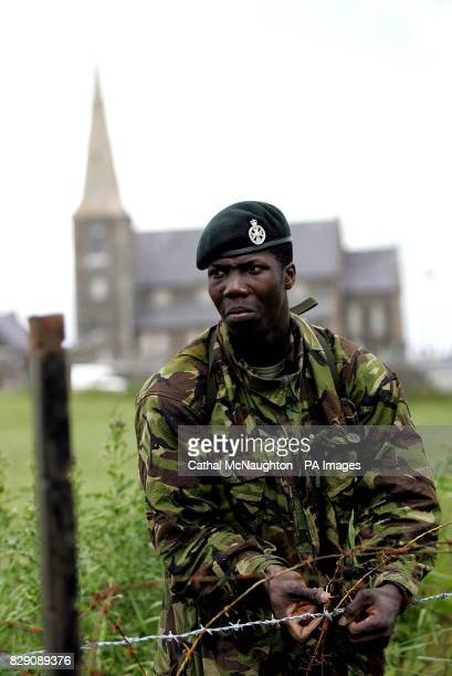 A soldier from the Royal Greenjackets erects barbed wire below Drumcree Parish Church in Portadown Security in the area has been stepped up ahead of...