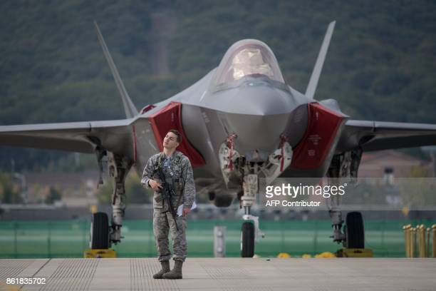 A US soldier guards a US F35 stealth aircraft at the Seoul International Aerospace and Defense Exhibition in Seongnam south of Seoul on October 16...