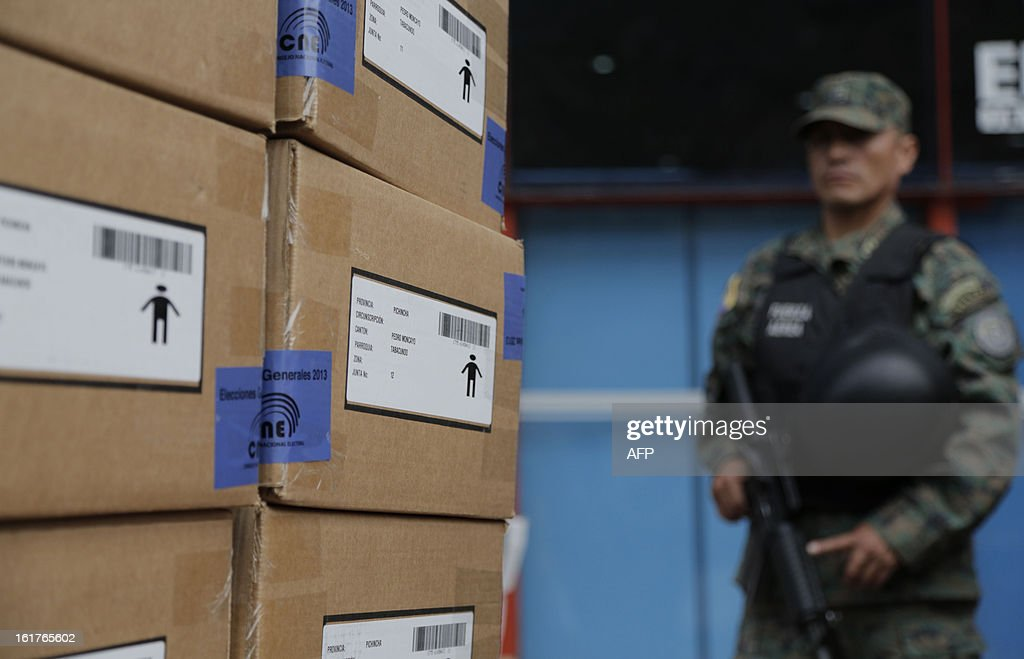 A soldier guards electoral kits from the Ecuadorean Electoral National Council, before they are shipped for Sunday's national election, in Quito, on February 15, 2013. Ecuadoran President Rafael Correa is favored to cruise to a new term Sunday to cement a 'socialist revolution' that has brought stability to a nation where several leaders were forced out before him. An outspoken voice of the Latin American left and friend of ailing Venezuelan President Hugo Chavez, the charismatic, US-educated economist is far ahead of his seven rivals in all opinion polls after six years in office.