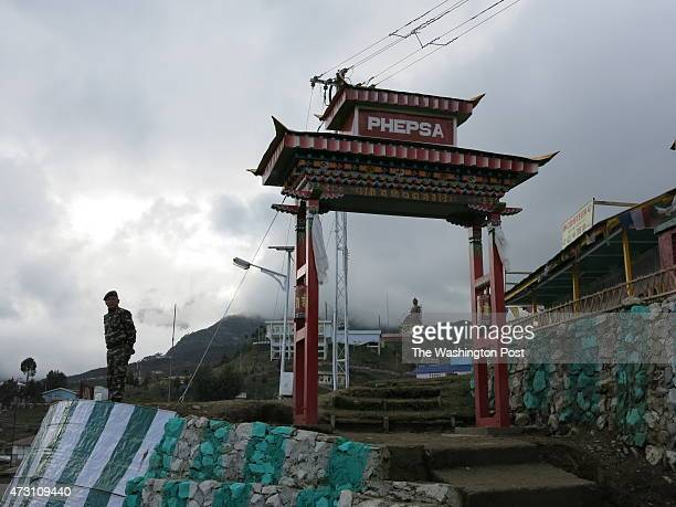 Soldier guards military installation in Tawang This Indian town with its historic monastery is in the Indian state of Arunachal Pradesh which has...