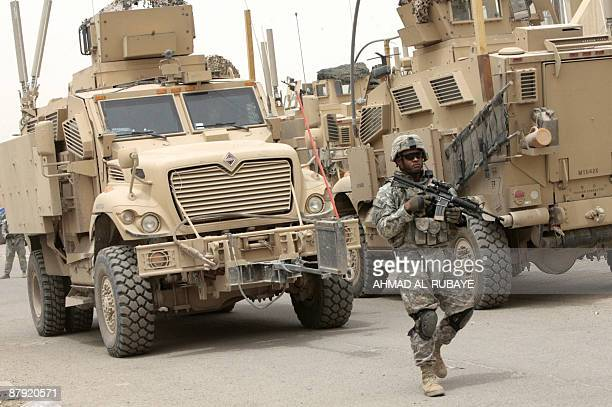 A US soldier guards the entrance to the Shaab stadium in Baghdad at the start of a football match between an USIraqi military team and a local Iraqi...