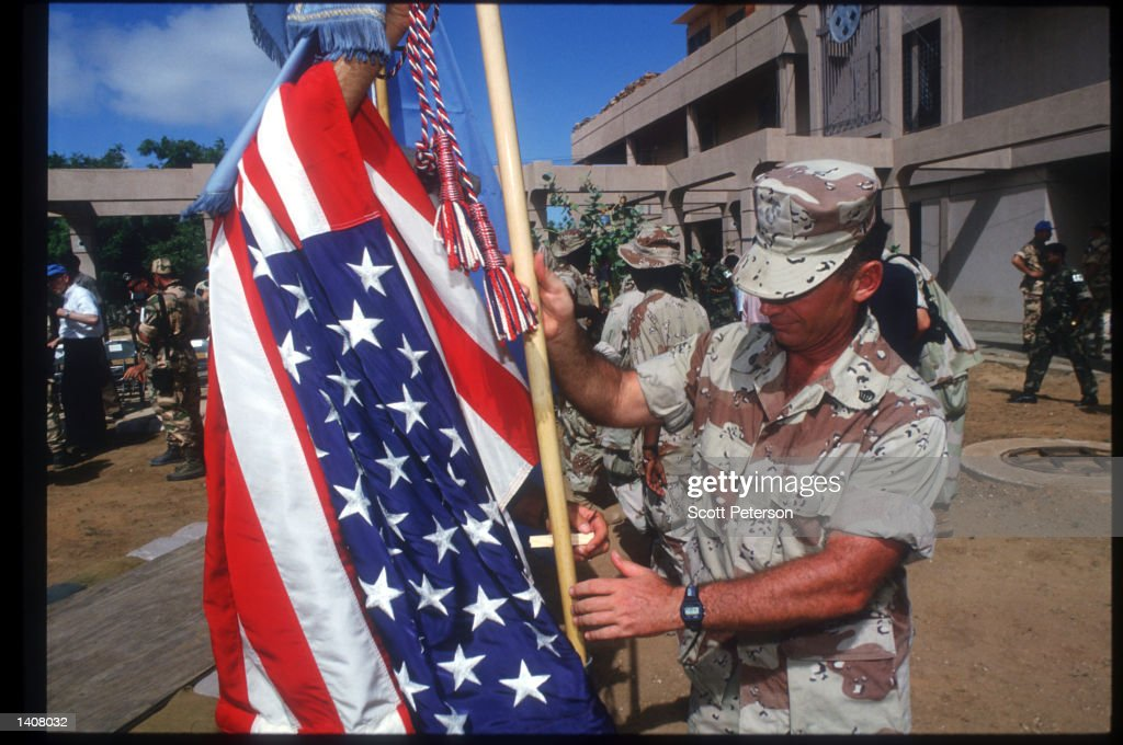 US soldier handles the American flag May 4 1993 in Mogadishu Somalia Following the departure of US forces UN troops will continue the humanitarian...