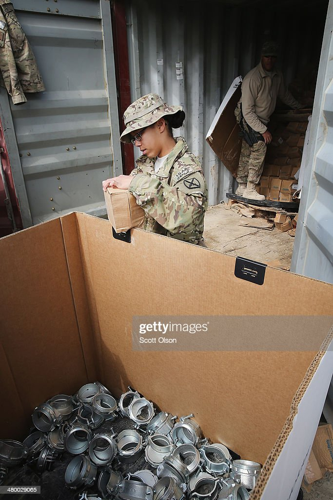 A soldier helps to fill a pallet with excess electrical connectors left by a departing unit as the U.S. continues draws down manpower in the 13-year-old war on March 22, 2014 near Gardez, Afghanistan. The connectors are slated to be sold for scrap. In the past year the U.S. Military has been reducing troops and equipment in Afghanistan as it transitions from a role of combatants, fighting alongside Afghan soldiers, to assisting the Afghan National Security Forces in an advisory role. President Obama recently ordered the Pentagon to develop a contingency plan for a complete pullout from Afghanistan by the end of 2014 if Afghanistan President Hamid Karzai or his successor refuses to sign the Bilateral Security Agreement.