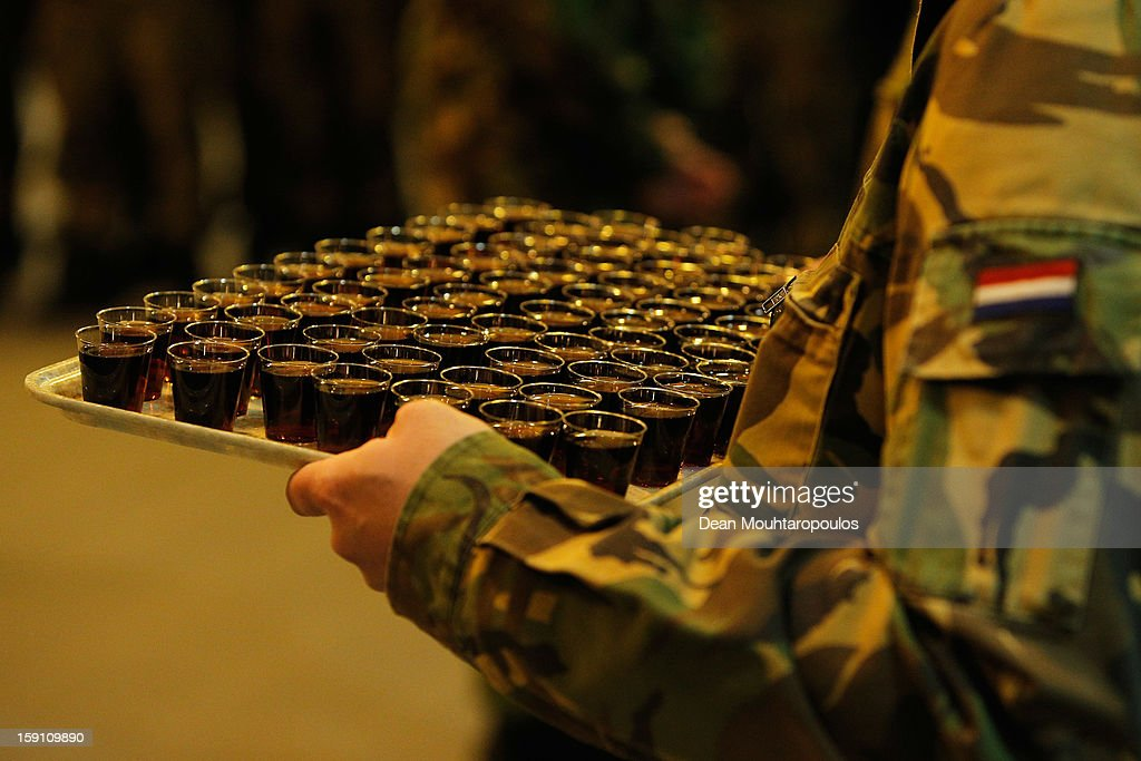 A soldier holds a tray of drinks for the Netherlands and Germany soldiers as they are transfered to Turkey from Eindhoven Military Airport on January 8, 2013 in Eindhoven, Netherlands. This advance party of Dutch and German troops will fly to Turkey to prepare for the arrival of the Patriots with the main body of European soldiers arriving later in the month. The Dutch have a tradition of sharing a drink prior to going on a mission.