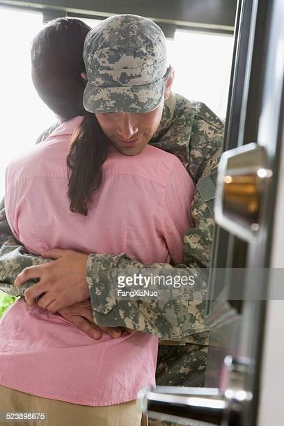 Soldier Hugging Woman