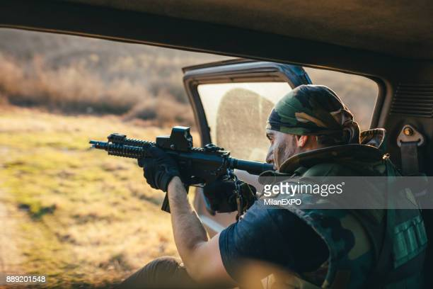 Soldier in back of vehicle