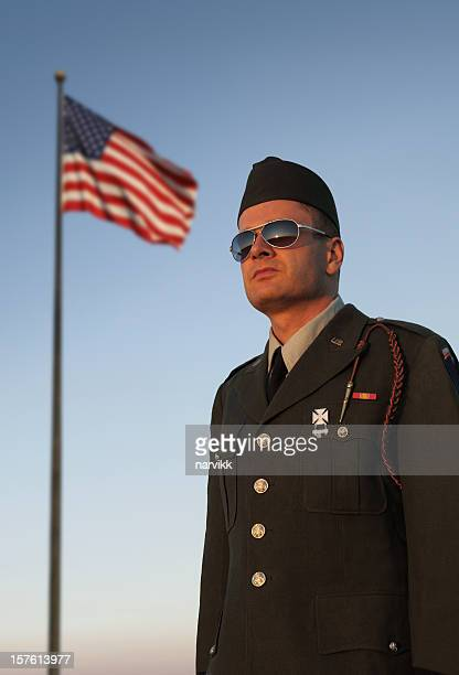 US Soldier in Front of American Flag