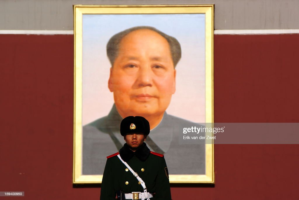 CONTENT] Soldier in front of Mao image Forbidden City Beijing.