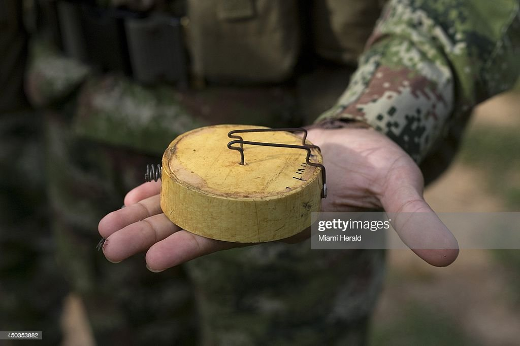 A soldier in La Julia, Colombia shows off a model of an anti-personnel mine used by FARC guerrillas, on May 21, 2014.