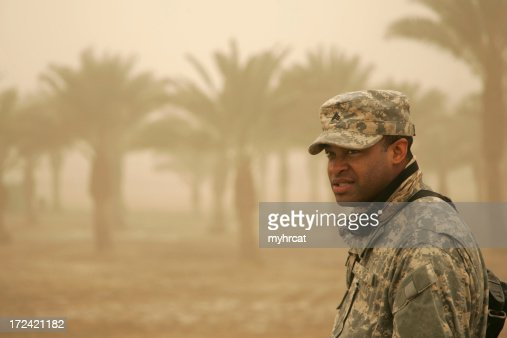 Soldier in Sandstorm Straining to See