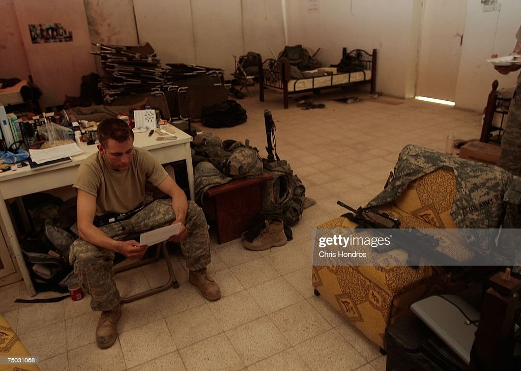 A soldier in the 2nd Battalion 23rd Infantry Regiment of the 2nd Infantry Division out of Fort Lewis Washington reads a letter from home in a former...