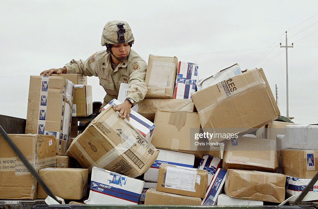 S. soldier in the 82nd Airborne Division looks over packages and presents for soldiers December 24, 2003 in Camp Mercury, near the Iraqi town of Fallujah. Troops in Iraq paused only briefly for the Christian holiday, with soldiers using the day to open presents and cards from friends and family back home.