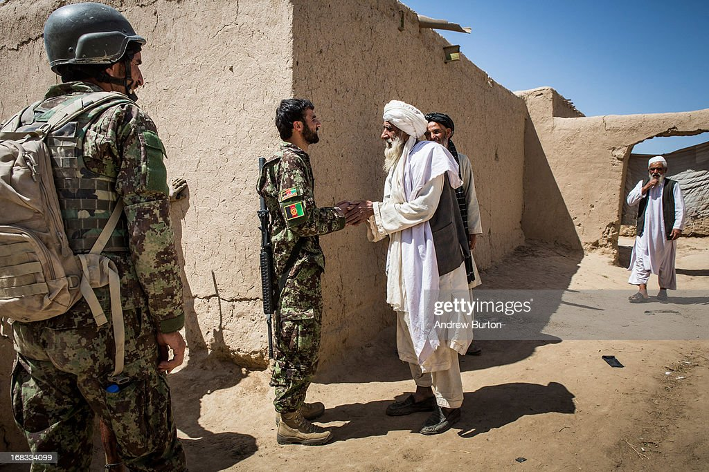 A soldier in the Afghan National Army's 6th Kandak 3rd company meets with locals during a joint patrol with the US Army's 1st Battalion 36th Infantry...